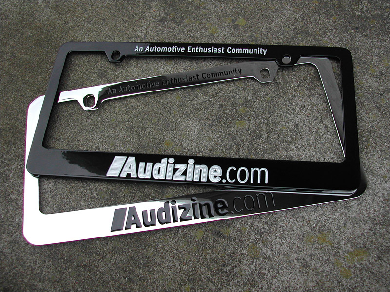 the audizine logo and tagline an automotive enthusiast community have been etched from a gloss black powder coated zinc frame then filled with a